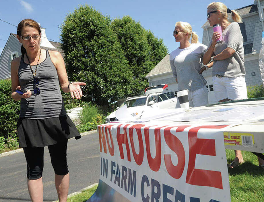 Maggie Trujillo supporting the No House on Farm Creek cause speaks to neighbors in Rowayton Sunday morning. Hour photo/Matthew Vinci