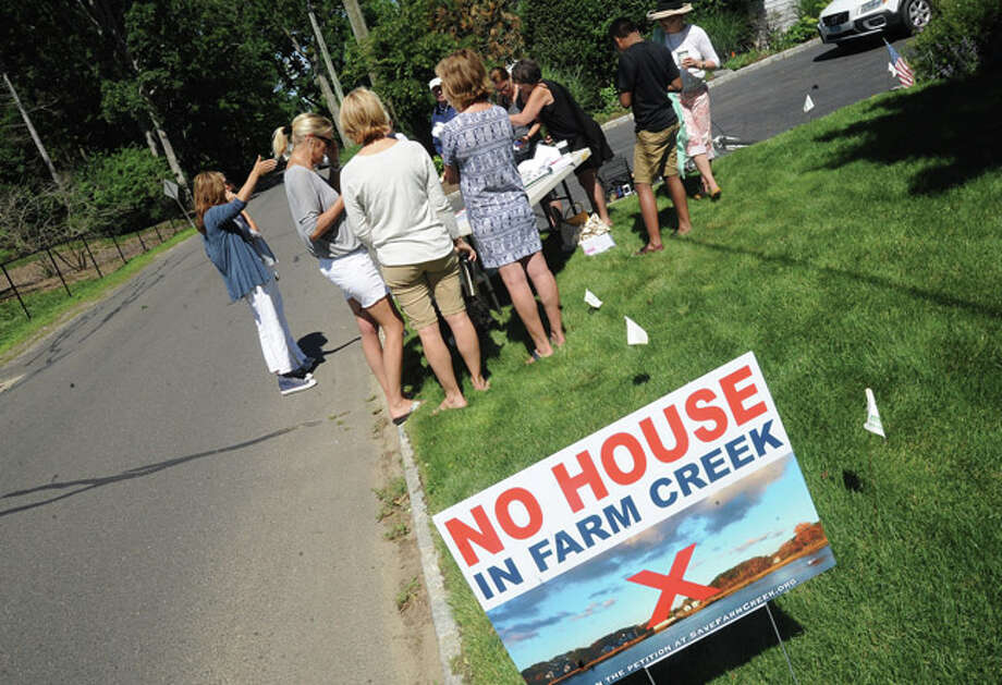 Supporters of No House on Farm Creek gather to spread the word Sunday in Rowayton. Hour photo/Matthew Vinci