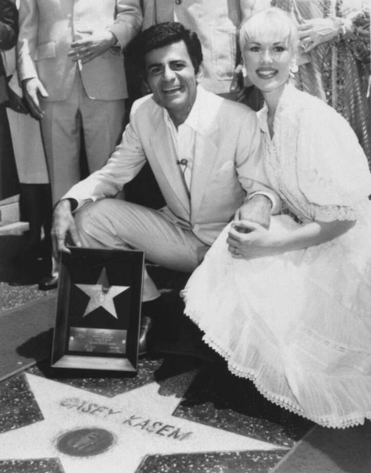 "FILE - In this April 27, 1981 file photo, Casey Kasem and his wife Jean smile as he receives his own ""Star"" on the Hollywood Walk of Fame in Los Angeles. Kasem, the smooth-voiced radio broadcaster who became the king of the top 40 countdown, died Sunday, June 15, 2014, according to Danny Deraney, publicist for Kasem's daughter, Kerri. He was 82. (AP Photo/File)"