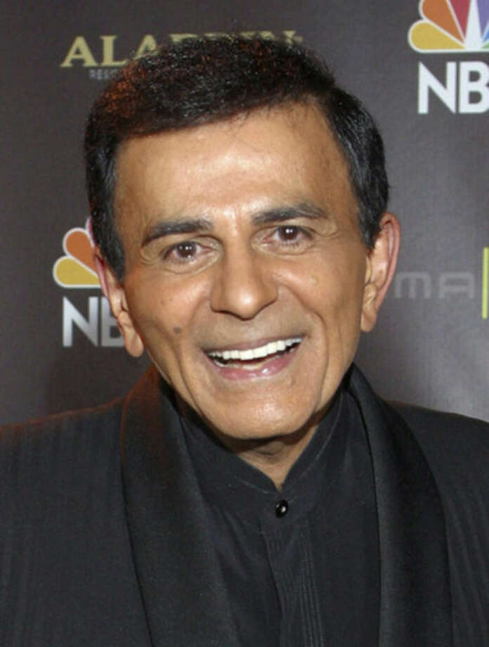 FILE - In this Oct. 27, 2003 file photo, Casey Kasem poses for photographers after receiving the Radio Icon award during The 2003 Radio Music Awards at the Aladdin Resort and Casino in Las Vegas. Kasem, the smooth-voiced radio broadcaster who became the king of the top 40 countdown, died Sunday, June 15, 2014, according to Danny Deraney, publicist for Kasem's daughter, Kerri. He was 82. (AP Photo/Eric Jamison, file)