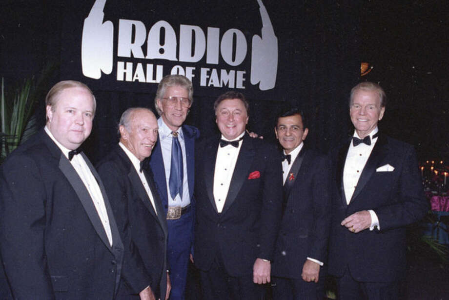 """FILE - In this Nov. 15, 1992 file photo, Bruce Dumont, president of the Museum of Broadcast Communication, far left, stands with inductees, from left, ABC radio pioneer Leonard Goldenson, country music's Porter Wagoner, Detroit radio personality J.P. McCarthy, and """"Top 40"""" host Casey Kasem, into the museum's Hall of Fame in Chicago, Ill. Also participating in the ceremony is Paul Harvey, far right. Kasem, the smooth-voiced radio broadcaster who became the king of the top 40 countdown, died Sunday, June 15, 2014, according to Danny Deraney, publicist for Kasem's daughter, Kerri. He was 82. (AP Photo/Fred Jewell, file)"""