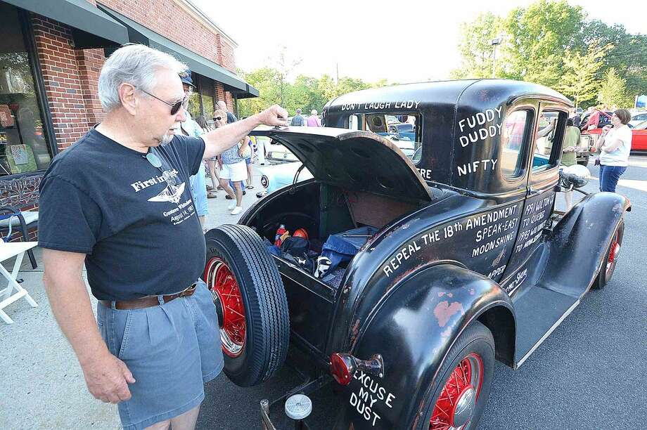 Hour Photo/Alex von Kleydorff Pete Everson opens the trunk of his original 1931 Ford Model A, complete with period phrases painted all over the body duringThe 15th annual Wilton Kiwanis, Geeb Fleming/Nick Allegretta Memorial Cruise Night