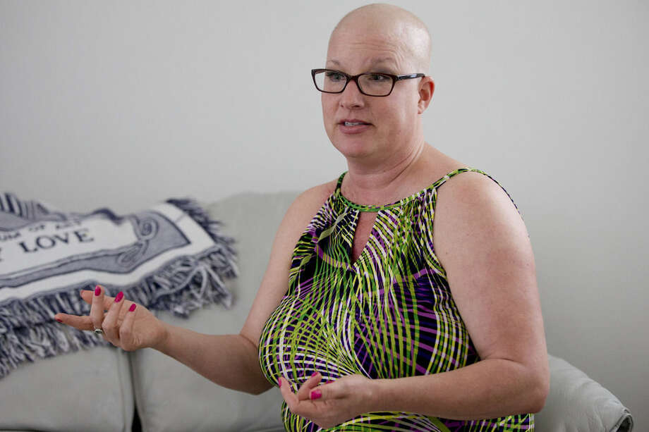 Theresa Roberts, 45, of Kalamazoo, Michigan speaks during an interview with The Associated Press Wednesday, June 24, 2015, in Philadelphia. Roberts who has breast cancer is in town for radiation treatments at Thomas Jefferson and staying at Sue and Reinhard Kruse's home. Hosts for Hospitals, a nonprofit, is looking to double its base of 50 host families so sick people far from home won't have to postpone such care during Pope Francis' scheduled visit to Philadelphia in Sept. (AP Photo/Matt Rourke)