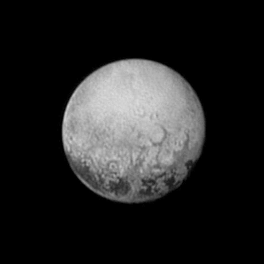 This July 11, 2015, image provided by NASA shows Pluto from the New Horizons spacecraft. On Tuesday, July 14, NASA's New Horizons spacecraft will come closest to Pluto. New Horizons has traveled 3 billion miles over 9? years to get to the historic point. (NASA/JHUAPL/SWRI via AP)