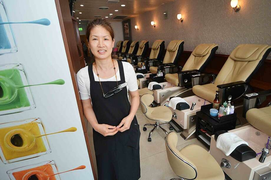 Hour Photo/Alex von Kleydorff CoCo Nails owner Sarah Geick in her spa in Wilton center