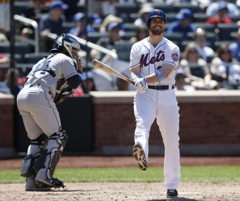 San Diego Padres catcher Rene Rivera collects the ball as New York Mets' Daniel Murphy, right, reacts after striking out with Curtis Granderson on base in the fourth inning of a baseball game, Sunday, June 15, 2014, in New York. (AP Photo/Kathy Willens)