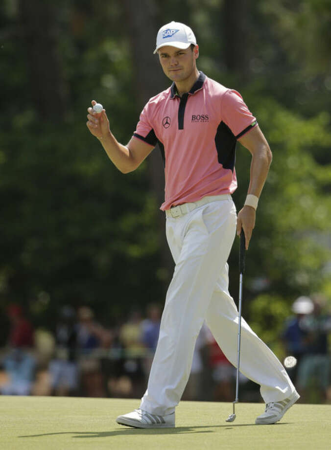 Martin Kaymer, of Germany, waves after a par on the first green during the third round of the U.S. Open golf tournament in Pinehurst, N.C., Saturday, June 14, 2014. (AP Photo/Chuck Burton)
