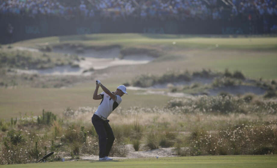 Martin Kaymer, of Germany hits his tee shot on the 13th hole during the final round of the U.S. Open golf tournament in Pinehurst, N.C., Sunday, June 15, 2014. (AP Photo/Matt York)