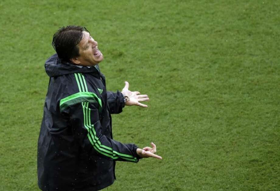 Mexico's head coach Miguel Herrera reacts after a goal was disallowed to his team during the group A World Cup soccer match between Mexico and Cameroon in the Arena das Dunas in Natal, Brazil, Friday, June 13, 2014. (AP Photo/Hassan Ammar)