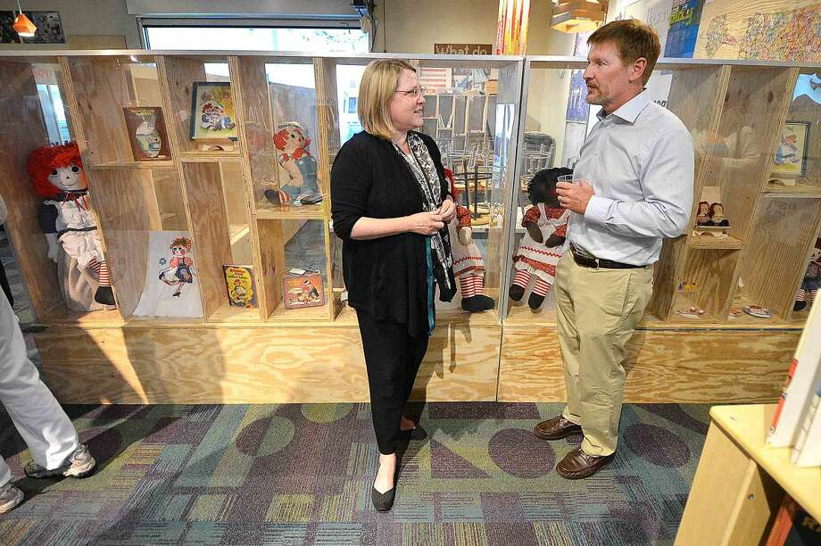 stepping Stones Museum for Children Executive Director Rhonda Kiest talks with David Westmoreland, chairman of the city of Norwalk Historical Commission, during a reception for the opening of the exhibit Raggedy Ann Native of Norwalk.