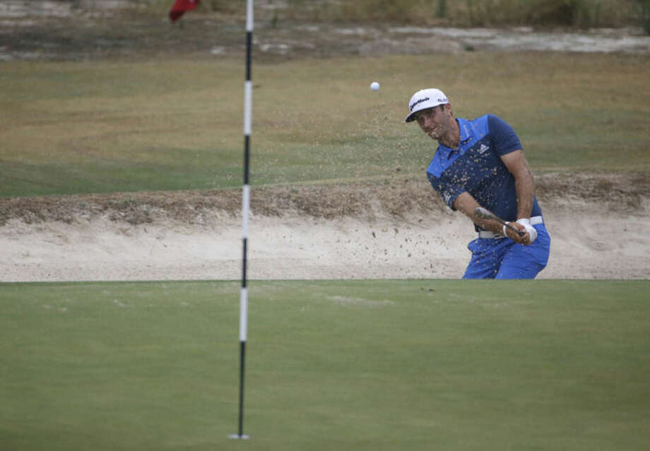 Dustin Johnson hit out of the bunker on the 12th hole during the second round of the U.S. Open golf tournament in Pinehurst, N.C., Friday, June 13, 2014. (AP Photo/David Goldman)
