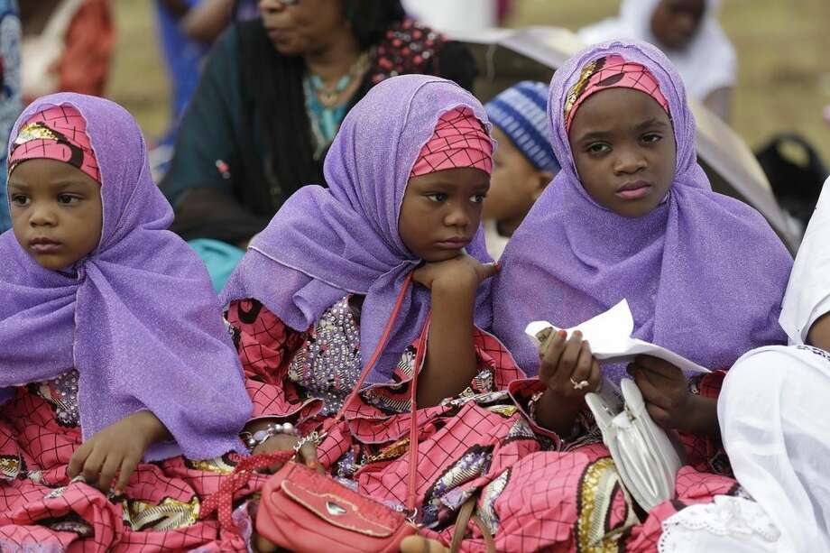 Nigeria Muslim girls attend Eid al-Fitr prayer, marking the end of the Muslim holy fasting month of Ramadan in Lagos, Nigeria, Friday, July 17, 2015. (AP Photo/Sunday Alamba)