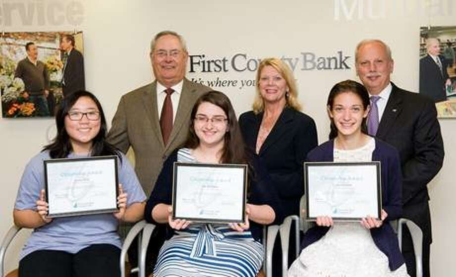 Bottom from left: Casey Bang, Staples High School, Lila Sferlazza, Norwalk High School, and Claire Howlett, Westhill High School, are recipients of the Richard E. Taber Citizenship Award scholarship which is administered by First County Bank Foundation. Top from left: Richard E. Taber, retired president of First County Bank Foundation and retired chairman & CEO of First County Bank; Katherine Harris, vice president of First County Bank Foundation and president & COO of First County Bank; Reyno A. Giallongo, Jr., president of First County Foundation and chairman & CEO of First County Bank.