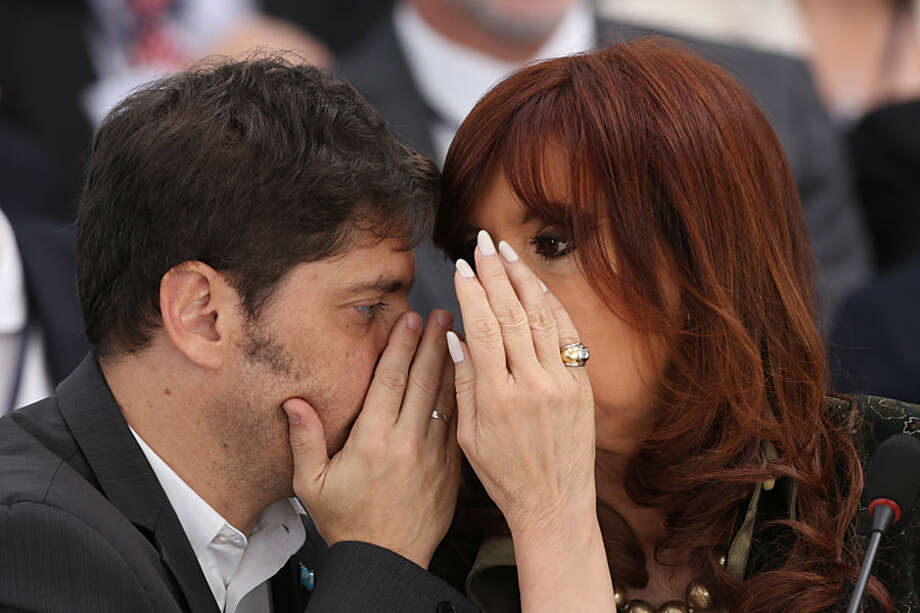 Argentina's President Cristina Fernandez, right, talks with her Economy Minister Axel Kicillof during a Mercosur Summit at Itamaraty Palace in Brasilia, Brazil, Friday, July 17, 2015. Mercosur is a South American trade group. (AP Photo/Joedson Alves)