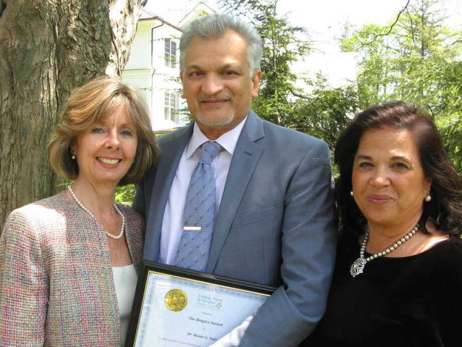 Dr. Kesav Nairof Wilton received an award for his volunteer work as a Hospice Advisor to Visiting Nurse & Hospice of Fairfield County. He is pictured here with Sharon Bradley, Agency President and CEO, and Christine Pfeffer, Hospice Director.