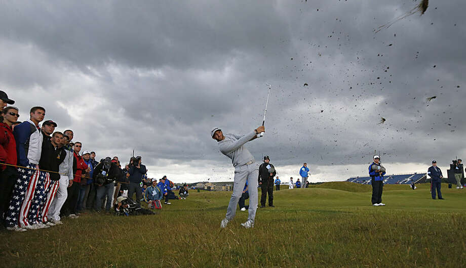 United States' Dustin Johnson plays out of the rough on the 4th hole during the second round of the British Open Golf Championship at the Old Course, St. Andrews, Scotland, Friday, July 17, 2015. (AP Photo/Jon Super)
