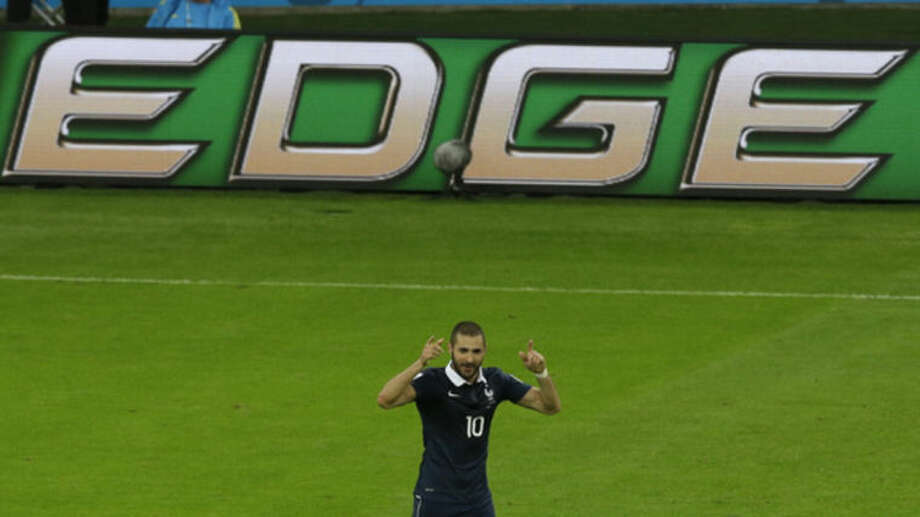 France's Karim Benzema celebrates scoring his side's 3rd goal during the group E World Cup soccer match between France and Honduras at the Estadio Beira-Rio in Porto Alegre, Brazil, Sunday, June 15, 2014. (AP Photo/Andrew Medichini)