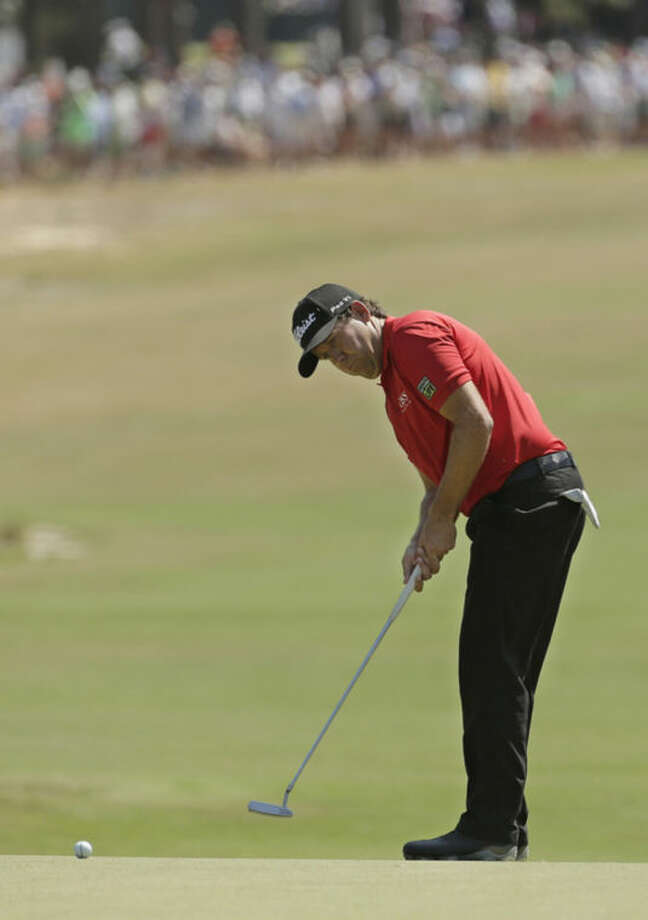Erik Compton watches his putt on the first hole during the final round of the U.S. Open golf tournament in Pinehurst, N.C., Sunday, June 15, 2014. (AP Photo/Charlie Riedel)