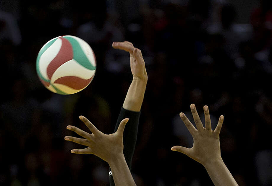 Lauren Paolini of the U.S., wearing a black arm protector, spikes the ball during the United States team's women's volleyball preliminary match against Peru at the Pan Am Games in Toronto, Thursday, July 16, 2015. (AP Photo/Rebecca Blackwell)