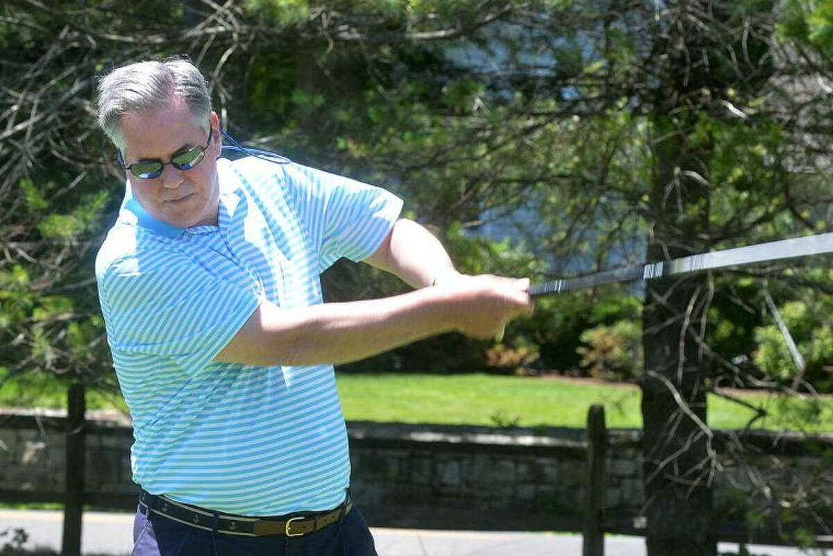 Hour Photo/Alex von Kleydorff Norwalk Chamber of Commerce President and CEO Ed Musante drives down the fairway during the Chambers Golf Classic at Shorehaven Country Club