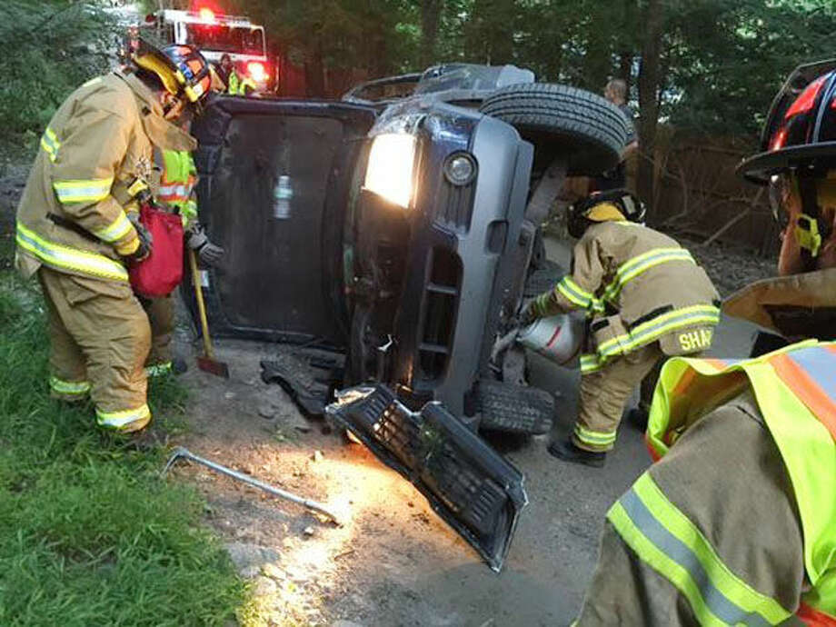 Photo courtesy Weston Fire Department Weston Fire and Police respond to a rollover accident on Newtown Turnpike early Friday morning. The lone driver was unharmed.