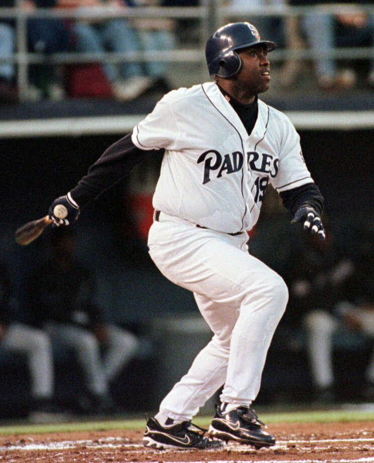 FILE - In this April 24, 1999 file photo, San Diego Padres' Tony Gwynn watches his first inning home run against the Arizona Diamondbacks, in San Diego. The Baseball Hall of Fame said Gwynn died of cancer on Monday, June 16, 2014. He was 54. (AP Photo/Denis Poroy, File)