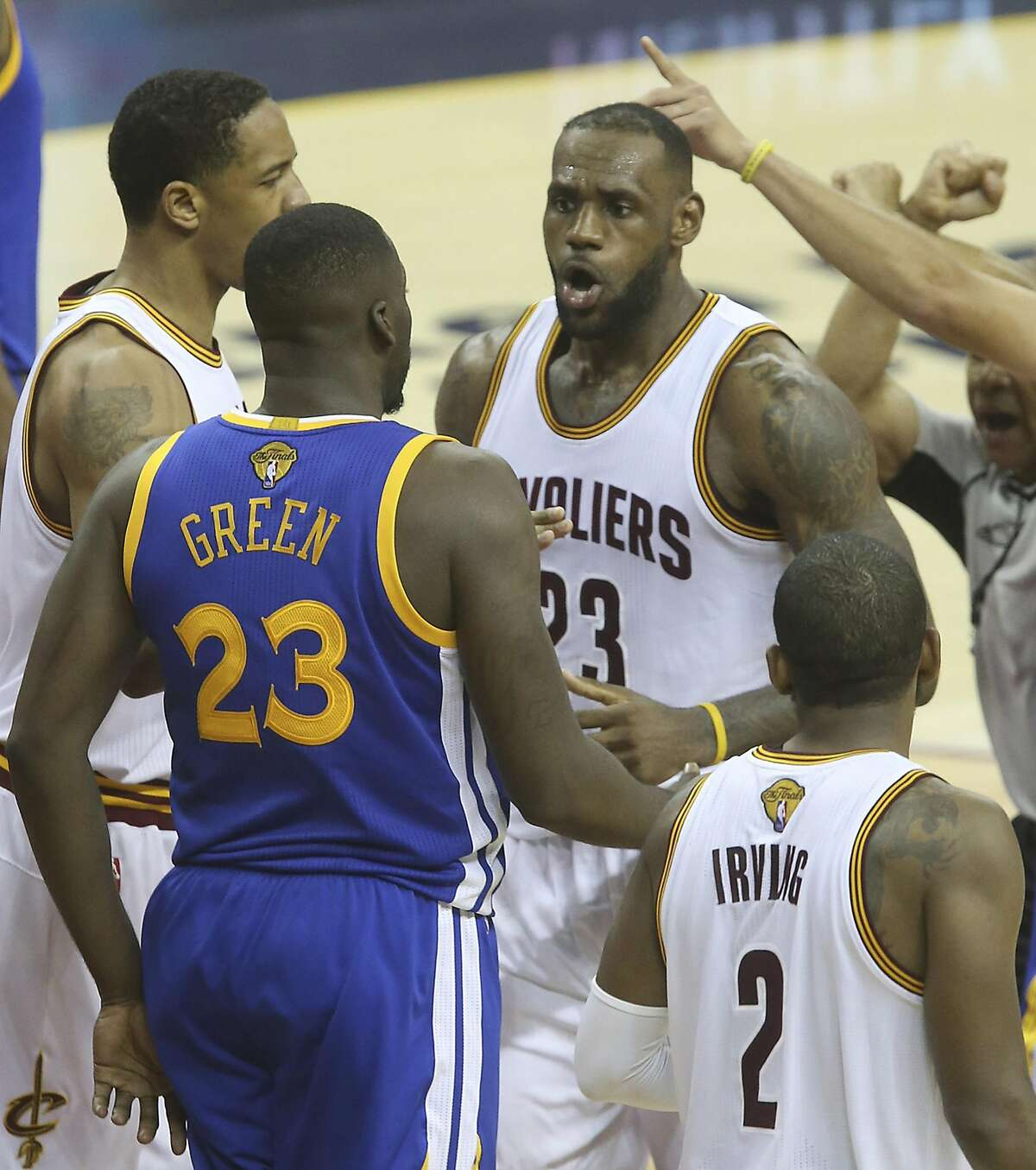 The Cleveland Cavaliers' LeBron James, middle, gets tangled with the Golden State Warriors' Draymond Green, left, during the fourth quarter in Game 4 of the NBA Finals at Quicken Loans Arena in Cleveland on Friday, June 10, 2016. The Warriors won, 108-97, for a 3-1 series lead. (Phil Masturzo/Akron Beacon Journal/TNS)