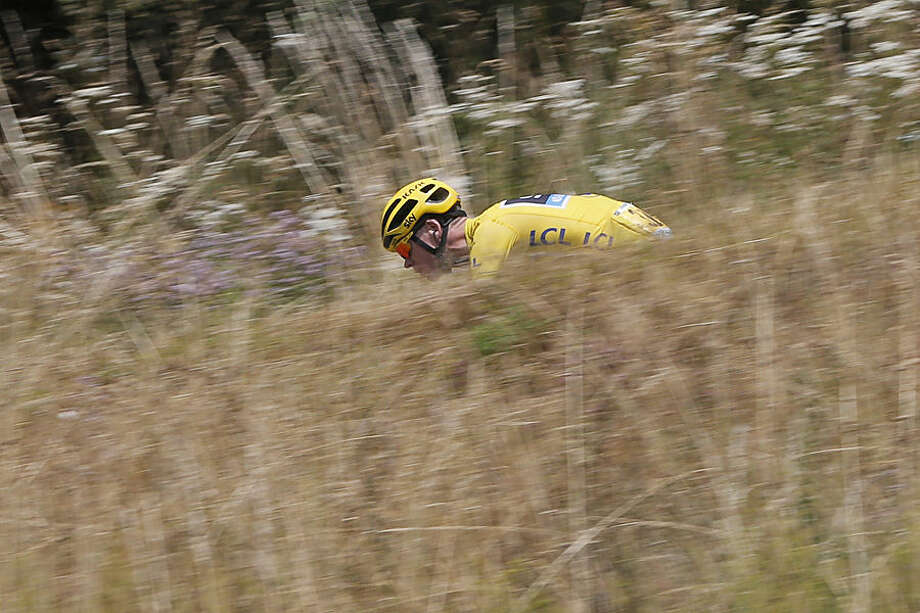 Britain's Chris Froome, wearing the overall leader's yellow jersey, speeds downhill during the twelfth stage of the Tour de France cycling race over 195 kilometers (121.2 miles) with start in Lannemezan and finish in Plateau de Beille, France, Thursday, July 16, 2015. (AP Photo/Christophe Ena)