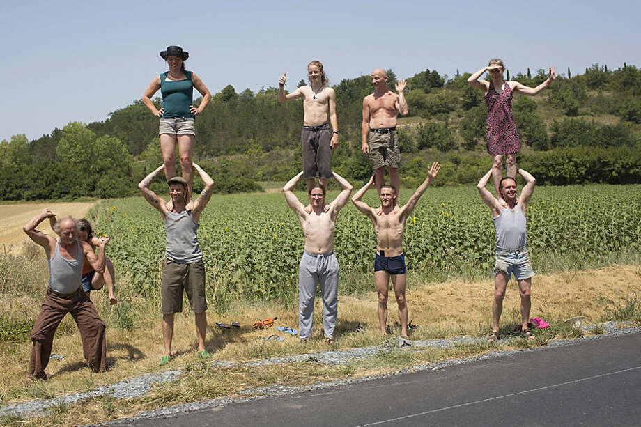 Spectators wait for the pack to pass during the thirteenth stage of the Tour de France cycling race over 198.5 kilometers (123.3 miles) with start in Muret and finish in Rodez, France, Friday, July 17, 2015. (AP Photo/Laurent Cipriani)