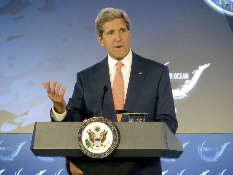 Secretary of State John Kerry addresses the Our Ocean conference, Monday, June 16, 2014, at the State Department in Washington. The Obama administration is willing to talk with Iran over deteriorating security conditions in Iraq and is not ruling out potential U.S.-Iranian military cooperation in stemming the advance of Sunni extremists, Kerry said Monday. (AP Photo/Lauren Victoria Burke)