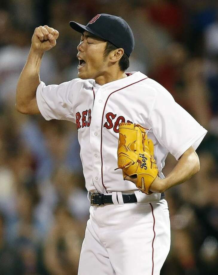 Boston Red Sox's Koji Uehara reacts after Minnesota Twins' Kendrys Morales lined out in the ninth inning of a baseball game in Boston, Monday, June 16, 2014. The Red Sox won 1-0. (AP Photo/Michael Dwyer)