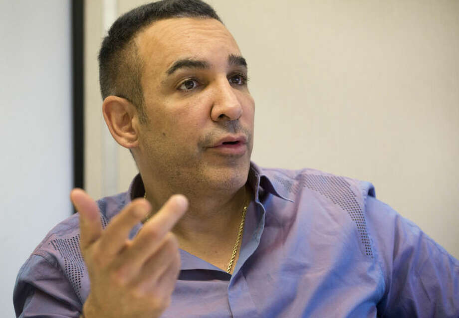 In this March 27, 2014 photo, Alki David, CEO of FIlmOn, is interviewed at The Associated Press in New York. FilmOn offers over-the-air TV channels through a website and mobile apps. (AP Photo/Mark Lennihan)