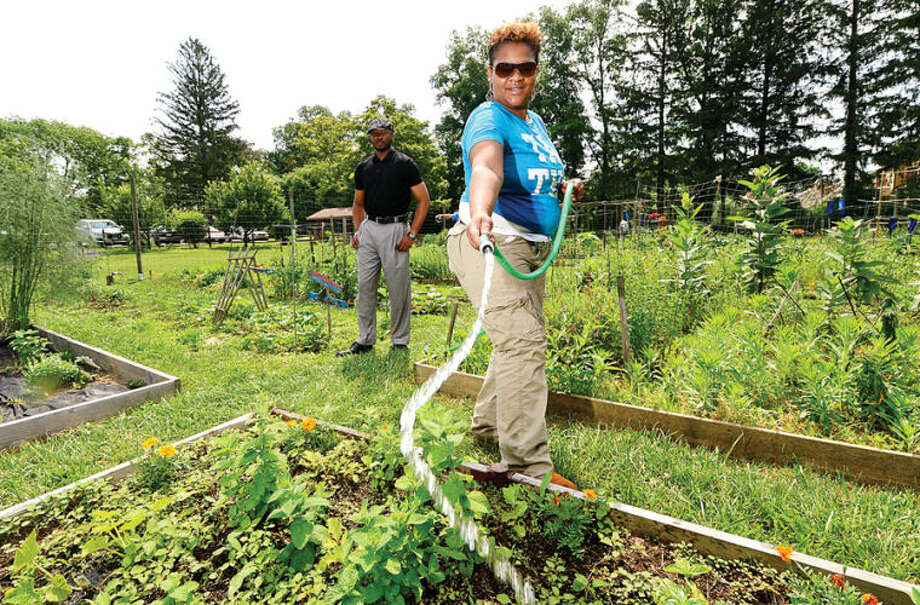 Hour photo / Erik Trautmann For the fifth year in a row, Family & Children's Agency's Homeless Services clients including Helena Miserocchi and Jamal Benbow tend garden plots at Fodor Farms. In addition to providing valuable lessons on nutrition and vocational skills, gardening allows these clients to be active within their community in a program that promotes overall well-being.