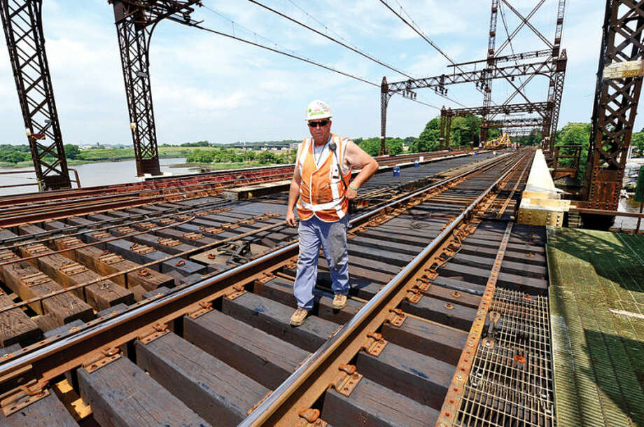 Hour photo / Erik Trautmann Metro-North Railroad and CT DOT officials, including Metro-North Structural Welder Foreman John Boddie, give local media a tour of the inner workings of the 118-year-old Walk train bridge in Norwalk Wednesday.