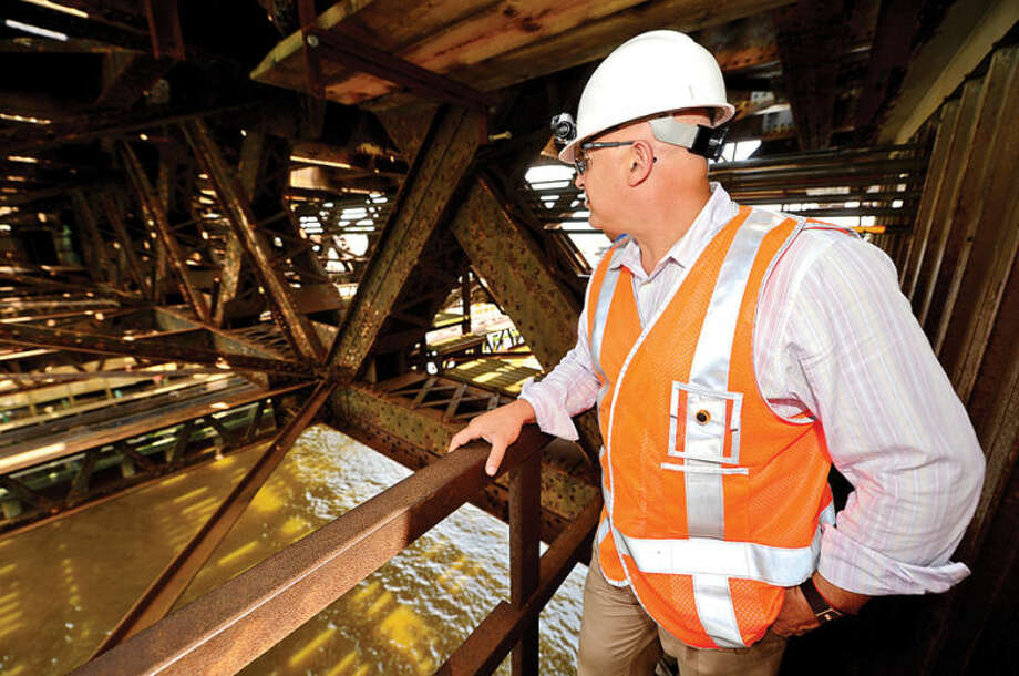 Hour photo / Erik Trautmann Metro-North Railroad and CT DOT officials including Merto North Deputy Director of Structures, Leon Kagan, give local media a tour of the inner workings of the 118-year-old Walk train bridge in Norwalk Wednesday.