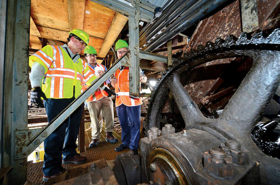 Hour photo / Erik Trautmann Metro-North Railroad and CT DOT officials including John Bernich, CT DOT Assistant Rail Administrator, give local media a tour of the inner workings of the 118-year-old Walk train bridge in Norwalk Wednesday.
