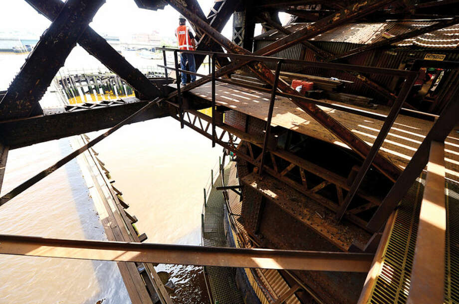 Hour photo / Erik Trautmann Metro-North Railroad and CT DOT officials give local media a tour of the inner workings of the 118-year-old Walk train bridge in Norwalk Wednesday.