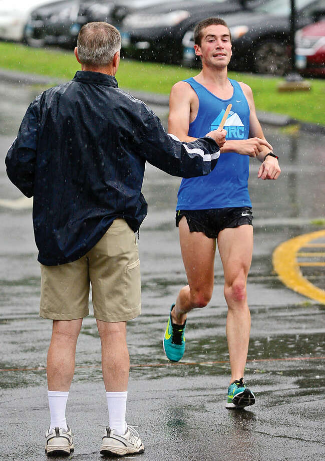 Hour photo / Erik Trautmann Kevin Hoyt finishes first as runners compete in the Westport Roadrunners Summer Series at Longshore Park in Westport Saturday.