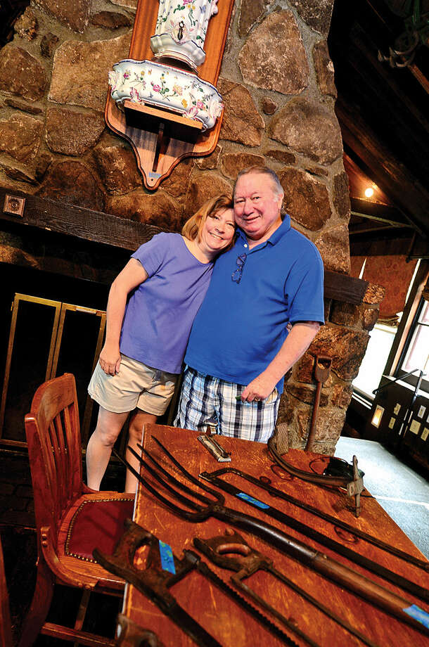 Hour photo / Erik Trautmann Laurie and Charlie Kenny wanted to have a anniversary dinner at the historic Red Barn Restaurant in Westport where they got engaged 30 years ago but the restaurant has closed and held a liquidation sale with Simply Estated Saturday.