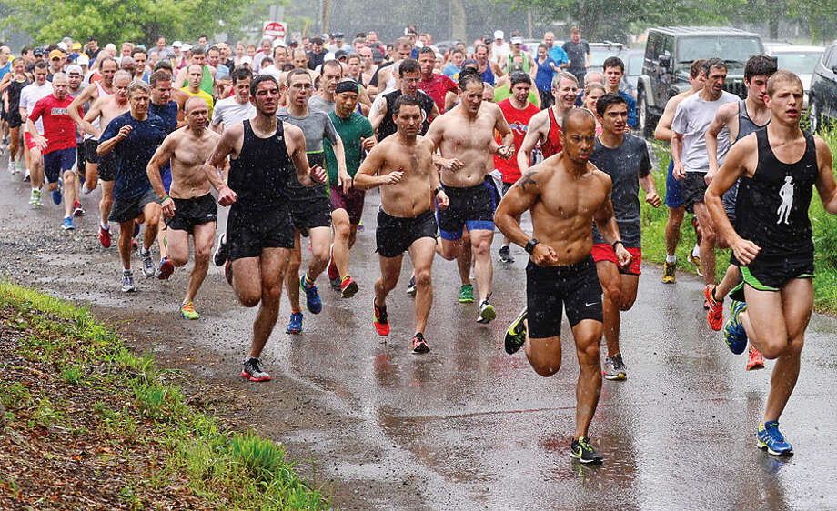 Hour photo / Erik Trautmann Runners compete in the Westport Roadrunners Summer Series at Longshore Park in Westport Saturday.