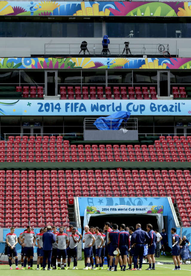 United States players congregate on the pitch during a training session in Recife, Brazil, Wednesday, June 25, 2014. The U.S. will play Germany in group G of the 2014 soccer World Cup on June 26. (AP Photo/Julio Cortez)