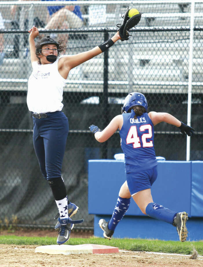 Hour photo/Chris Palermo. Westport's Milei Wyatt leaps for the catch during Westport's 3-1 loss to Waterford in the Little League softball state championship game in Bristol.