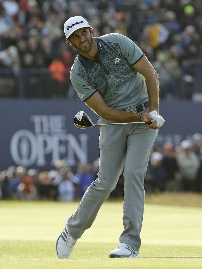 United States' Dustin Johnson follows his drive from the 18th tee during the second round of the British Open Golf Championship at the Old Course, St. Andrews, Scotland, Saturday, July 18, 2015. (AP Photo/David J. Phillip)