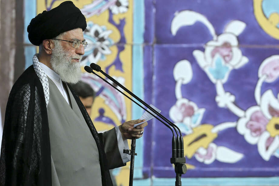 """In this picture released by an official website of the office of the Iranian supreme leader on Saturday, July 18, 2015, Supreme Leader Ayatollah Ali Khamenei delivers his sermon during the Eid al-Fitr prayer at the Imam Khomeini Grand Mosque in Tehran, Iran. Khamenei said a historic nuclear deal with world powers reached this week won't change Iran's policy towards the """"arrogant"""" government of the United States. (Office of the Iranian Supreme Leader via AP)"""