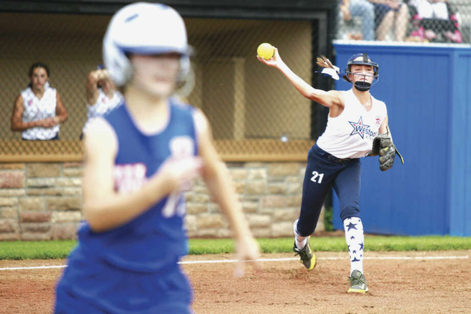 Hour photo/Chris PalermoWestport's Sophia Alfero throws to first against Waterford in the Little League softball state championship game in Bristol on Saturday.