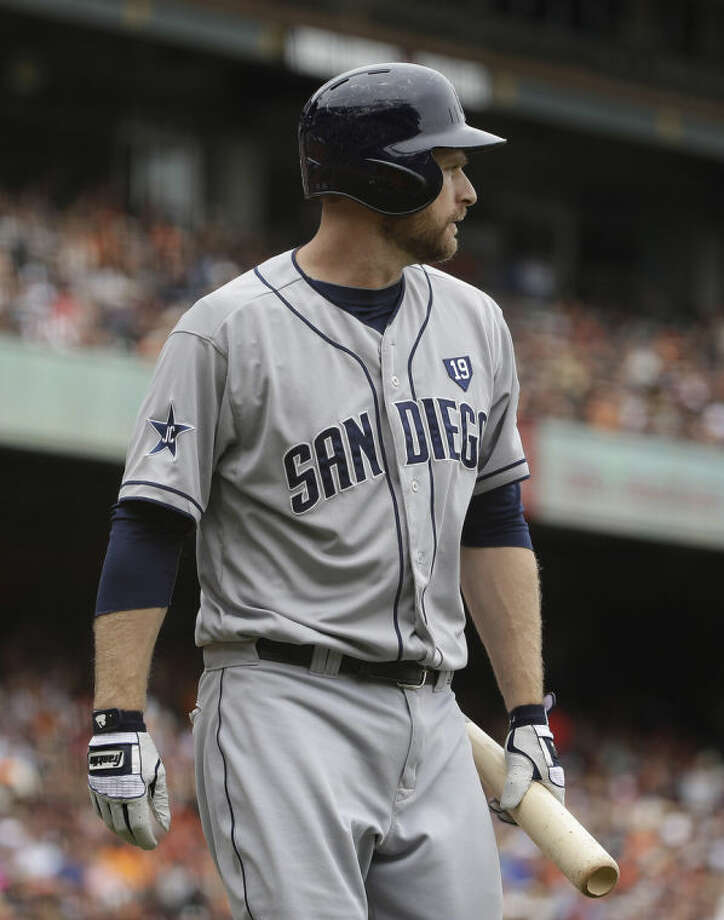 San Diego Padres' Chase Headley walks back to the dugout after striking out against San Francisco Giants starting pitcher Tim Lincecum in the fifth inning of their baseball game Wednesday, June 25, 2014, in San Francisco. (AP Photo/Eric Risberg)