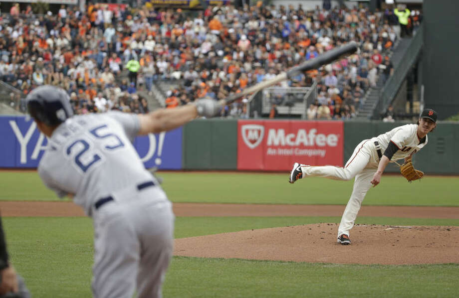 San Diego Padres' Will Venable strikes out swinging against San Francisco Giants starting pitcher Tim Lincecum in the first inning of their baseball game, Wednesday, June 25, 2014, in San Francisco. (AP Photo/Eric Risberg)