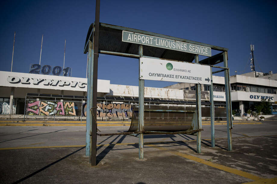 In this photo taken on Thursday, July 16, 2015, a general view at the west terminal of an abandoned old airport in eastern Athens. Now, in a bid to get a third European bailout, the ruling party has done an about face and is pledging to fast-track the waterfront project plus a host of other privatization efforts aimed at generating cash to help to reduce Greece's 320 billion euros national debt.(AP Photo/Petros Giannakouris)