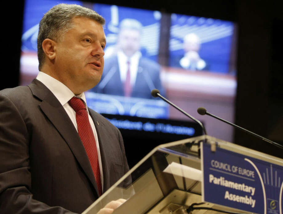 """Ukrainian President Petro Poroshenko delivers his speech at the Parliamentary Assembly of theCouncil of Europe in Strasbourg, eastern France, Thursday June 26, 2014. Poroshenko called on Russia to support his peace plan """"with deeds, not words."""" More than 300 people have been killed in eastern Ukraine in the past weeks as pro-Russian insurgents were fighting with government forces. Ukraine last Friday announced a unilateral cease-fire with the rebels. (AP Photo/Christian Lutz)"""