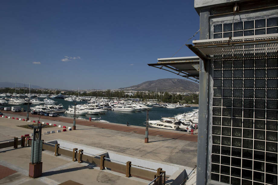 In this photo taken on Thursday, July 16, 2015, yachts docked at the marina of Agios Kosmas used for sailing events during Athens' 2004 Olympic games. Now, in a bid to get a third European bailout, the ruling party has done an about face and is pledging to fast-track the waterfront project plus a host of other privatization efforts aimed at generating cash to help to reduce Greece's 320 billion euros national debt.(AP Photo/Petros Giannakouris)